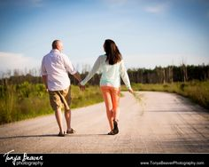 Walking together on a dirt road...Engagement Session Candid Moment   Jacksonville Engagement Photos - Tonya Beaver Photography006