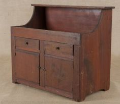 Pennsylvania child's stained poplar dry sink, late 19th c., 21'' h., 23'' w.