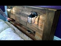 Pallet Wood Headboard with Coach Lights and a Recessed Shelf - How To Fix It Workshop. How To Build A Headboard With Shelves Reclaimed Wood Bed Frame, Wood Pallet Beds, Wood Pallets, Into The Woods, Headboard With Shelves, Headboard Ideas, Headboard Lights, Bedroom Ideas, Diy Bedroom