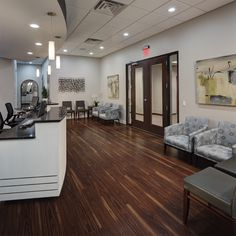 We were tasked in helping design the Fisher Family Chiropractic office! See how we helped them developed their office into a modern, and memorable space! Law Office Decor, Doctors Office Decor, Medical Office Decor, Dental Office Design, Office Interior Design, Office Interiors, Office Ideas, Design Offices, Modern Offices