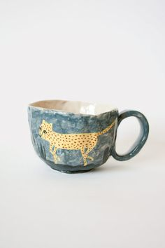 Wide cups with handle, minimal with underglaze painting, to compliment heavy glaze. Karin Hagen.