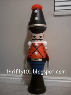terra cotta chirstmas soldier. the kids did this. they used feathers on top instead of pom-pom.