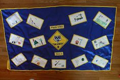 This is not the best picture, but here it is finished. I wanted to have my children hold it up, but they were busy doing other things today. Cub Scouts Wolf, Tiger Scouts, Girl Scouts, Cub Scout Den Flags, Rain Gutter Regatta, Cub Scout Activities, Wolf Den, Scout Mom, Pinewood Derby