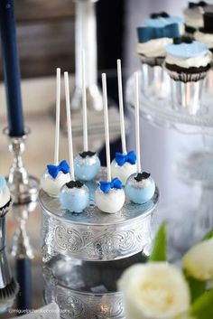 Bow tie cake pops at a little man mustache baby shower birthday party! See more party planning ideas at CatchMyParty.com!