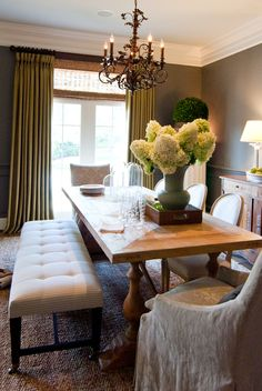 Dining room - love the comfy feel. Less rigid and formal. Bench and covered chairs actually seem luxurious.