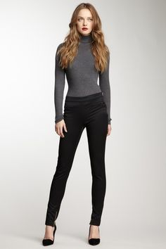 grey turtle neck with black anckle zip up black heels and an a really cute lipstick