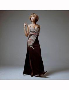 Lauren Hutton with firedbird-blaze dress by Galanos, Round-the-Clock tights, David Evins shoes, hair by Suga Vogue 1971 Bert Stern