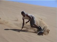 Sand boarding!!! I really want to try this in Great Sand Dunes National Park in Colorado.