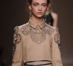 Valentino laser cut leather dress. Beautiful beige color and amazing lace details. Yet, would have been even better as a trench.