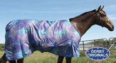 Jungle Blues Turnout Blanket 600D by Derby Originals. $69.95. 250 grams of polyfill. 600 denier nylon exterior and 210 denier lining. removable leg straps and attached tail cover. double front buckle with velcro and low cross surcingles. seamless spine. Turnout blanket made with breathable rip-stop nylon and polyfill lining. Fleece wither and front shoulder gussets for comfortable movement