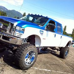 lifted two tone blue and white Ford truck