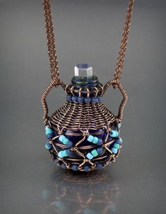 I found a little bottle at the bead show and thought I'd try and weave a little basket around it. --Lisa Barth