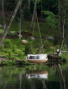 Not sure about the zillion pillows over water, but the swing is awesome!