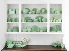 """In 1933, with the Great Depression at its height, consumers were on the hunt for affordable kitchen and dishwares. Pennsylvania's McKee Glass Company added green scrap glass to its opaque formula, producing an inexpensive product with a novel color that satisfied that demand. Following suit, Jeannette Glass began producing what they coined """"Jadite."""" In 1942, Anchor Hocking copied the look with their Fire-King line of """"Jade-ite."""""""