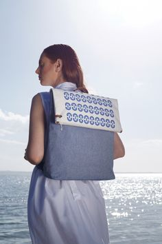 Twelve backpack with a removable top-clutch // design patent  Model: Sophia Zachariadou Clothing: Lefkon Photographs: Iro Simaioforidou