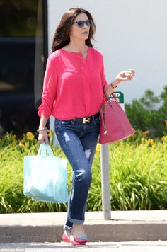 Hot pink: The star capped off her casual look with pink pumps, adorned with turquoise bows...