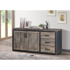 The transitional vintage style of this Heritage Rustic entertainment quickly becomes the focal point of your home decor with its distressed brown gray finish. The ample storage compartments and sturdy