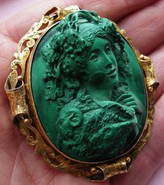 """Material: Malachite, 18K gold tested .    Size: just over 2 2/8"""" by just over 2""""    Date and Origin: Circa 1850/1860 Italy, frame  could be English."""