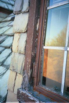 Deterioration at historic wood window frame.