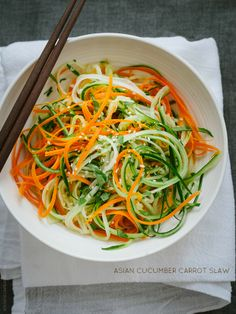Asian Cucumber Carrot Slaw | www.kitchenconfidante.com  Light, refreshing, and crunchy, this slaw pairs well with grilled chicken, fish, and pork!