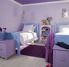 girls-room - The youngest Russell girls share a room their mother calls the Wisteria Wonderland. They prefer their Island Bunk Bed in Nikko Blue pulled apart. They also share a Smallest Island Bookshelf in Wisteria and at the foot of each girl's bed is a Bay Single Window Seat in Wisteria for storage.  Maine Cottage.