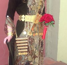 Beautiful light brown Kurdish dress decorated with patterned beads and diamonds paired with a gold belt and gold chain