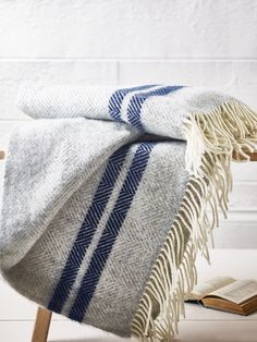 Beautifully hand woven in the UK from 100% pure wool, our large cream tasselled throw has a subtle grey chevron print with a vintage style French stripe design. Perfect for over your sofa or teamed with our French Stripe Quilt, this supersoft throw will keep you warm whatever the weather.