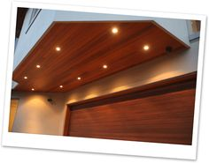 I love the effect of stained wood soffits with can lights. Very rich. Can Lights, Balinese, Ceilings, Ranch, Landscaping, Projects To Try, Entryway, New Homes, Houses