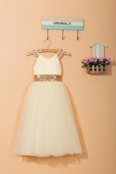 This ankle-length flower girl dress is made by fashionable sequins and soft tulle. With sparkling gold sequins on the bodice and an elegant cross back, the ivory cream dress looks chic and glamourous. The skirt is princess style with five layer of soft tulle which is suitable for girls aging from 1 to 14 years old. This beautiful, elegant and stylish handmade flower girl dress is perfect for wedding, and any special occasions or a simply dressing up item for your little princess!  All of…