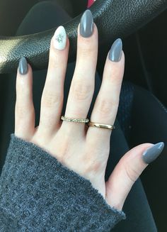 Grey and white nails with snowflake