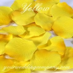 Gorgeous yellow silk rose petals are ideal for sprinkling on reception, buffet, and cake tables. - www.yourweddingcompany.com