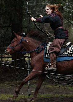 Katie Stearns and her horse, Magic, practice horseback archery at her ranch near Arlington. Stearns has traveled the world, including to Mongolia and ...