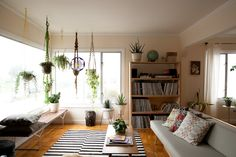 "Living area. http://www.refinery29.com/serena-mitnik-miller#slide-1   Tell us more about your shop, General Store, and what inspired you to open it.  ""My friends and the neighborhood itself inspired my husband, Mason, and I to open up a storefront in the Outer Sunset. We were looking for a studio space and when our old video store planned to move out we decided to make a go at a small storefront and studio.""  A glimpse at Serena's plant-centric living room!"