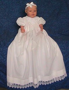 This precious little dress is made of baby soft cotton poly batiste. The bodice is hand smocked with Venice Lace trim and hand sewn