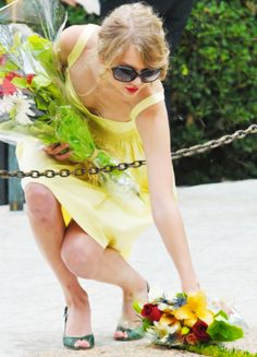 Taylor Swift giving flowers to the graves of veterans on veterans day!! <3