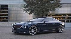 """Elmiraj advances Cadillac's provocative modern design and performance, contrasted with bespoke craftsmanship and luxury,"""" said Mark Adams, Cadillac design director. Description from examiner.com. I searched for this on bing.com/images"""