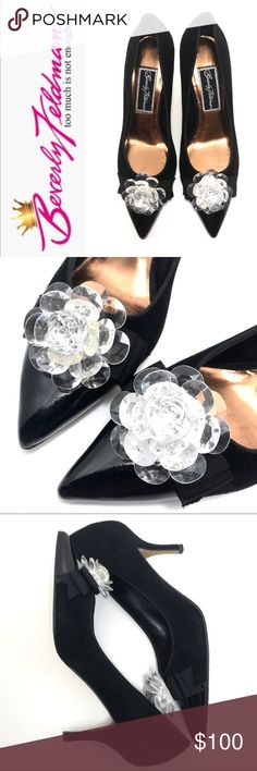 """Beverly Feldman Black Suede Heels • Crystal Flower Oh just Beautiful! Feminine, and Comfortable. The perfect evening shoe, dress shoe, or any event shoe.  Custom made in black suede with a patent leather toe, & a sparkling acrylic flower.  Beverly Feldman  Size 6.5. Pointed toe on a comfort tested forever last. Original Beverly Feldman vintage remake design. Padded cushioned insole and leather lining and sock. 2.5"""" heel that you always want but can never find. hand made flowered ornaments…"""