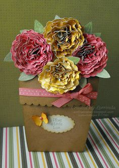 http://isntthatsweet.blogspot.com/2011/04/spring-flower-pot-pocket-card.html