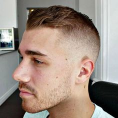 High Fade with Wavy Brushed Back Hair