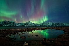 The Northern Lights dance over Norway's Lyngan Alps