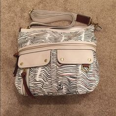 Fossil Morgan Top Zip Leather Trim cross-body Say Pockets a million times! Keep yourself organized with this Morgan cross-body from Fossil. It has a unique Zebra style print and the softly embossed Leather trim adds a modern and bold sophisticated look to it. Fossil Bags Crossbody Bags