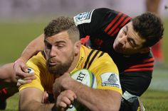 Callum Gibbins Photos Photos - Callum Gibbins of the Hurricanes dives over to score a try during the round 17 Super Rugby match between the Crusaders and the Hurricanes at AMI Stadium on July 16, 2016 in Christchurch, New Zealand. - Super Rugby Rd 17 - Crusaders v Hurricanes