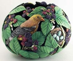 Carved Gourd with Sparrow, Nest and Eggs, Berries, and Leaves by Phyllis Sickles