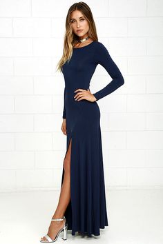 Feel like you're walking on air in the Swept Away Navy Blue Long Sleeve Maxi…