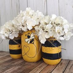 Set of 3 hand painted black and yellow Bumble Bee Mason jars. These hand painted jars are perfect for your shabby chic decor, farmhouse or rustic office decor. Jars are hand painted, distressed, and sealed with a clear matte f Mason Jar Gifts, Mason Jar Diy, Crafts With Mason Jars, Uses For Mason Jars, Halloween Mason Jars, Fall Mason Jars, Wine Bottle Crafts, Bottle Art, Diy Bottle