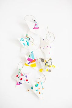 Gather the kids and make this easy origami Christmas art project out of paper that the little ones can paint however they choose. Kids of all ages will love adding color to these Simple Christmas Origami Star Ornaments that are pretty and vibrant. Christmas Origami, Noel Christmas, Christmas Crafts For Kids, Diy Christmas Ornaments, Simple Christmas, Childrens Christmas, Homemade Christmas, Holiday Crafts, Christmas Gifts