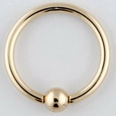 "One 14K Gold Captive Bead Ring: 12g 3/4"", 14K Gold Bead: 4mm (SOLD INDIVIDUALLY. ORDER TWO FOR A PAIR.) Body Circle Designs. $330.00. Save 50% Off!"