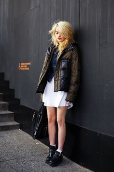I love the chunky boots and puffy jacket with the soft, chiffon-like dress. Totally balances out.