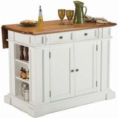 Expand your kitchen workspace by installing this large oak kitchen island. The butcher top features a leaf-top to give you extra space for chopping or mixing. Two drawers and two cabinets offer plenty of storage for your kitchen appliances.
