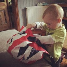 This curious cutie seems to be having fun getting to grips with his new Royal freebie! Thanks for the shot Kelly Gilson  Share yours #OBABYUK